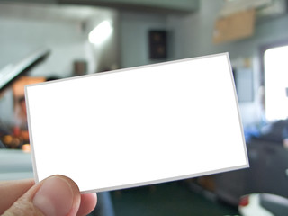 Hand holding blank visit card