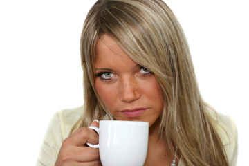 young woman is drinking out of a cup