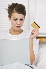 Attractive Woman with Credit Card and Laptop