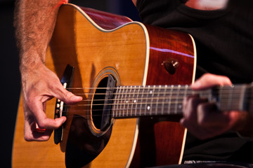 Guitarist hand with an classical guitar - sharp back hand