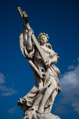 Angel with cross, in Rome, Italy