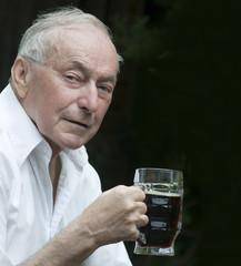 Senior man enjoying a pint
