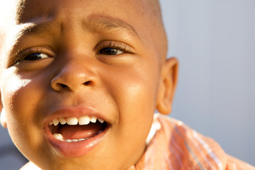 A Handsome little African American Boy smiling for the camera