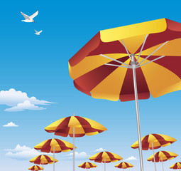 Colorful beach umbrellas against blue sky