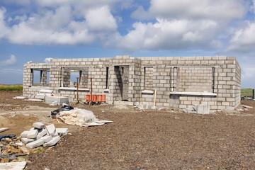 new build concrete stone House Construction blue sky