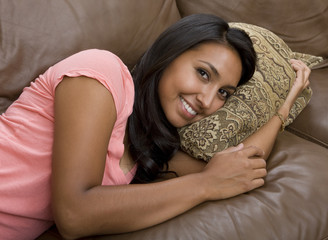 A beautiful woman relaxing on sofa