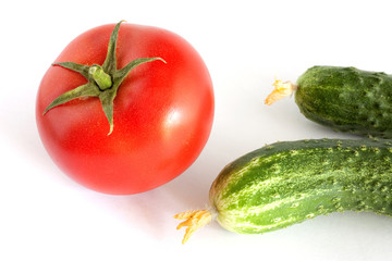 Still life with tomato and cucumbers