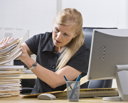 Woman Looking Through Paperwork