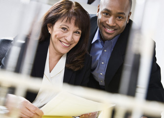 Businessman and Businesswoman With Document