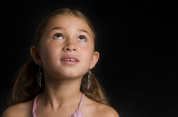 Cute girl looking up for inspiration or praying