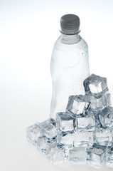 Ice cubes and mineral water bottle