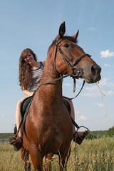 Girl sits on horseback