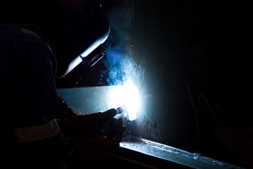 welder working and sparks