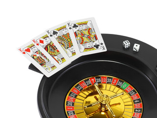 The casino roulette and playing cards. Isolated
