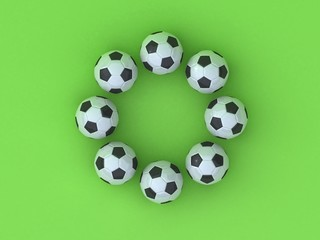 Circle from footballs on a green background