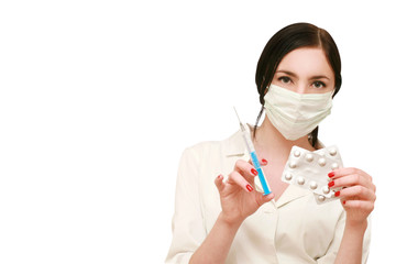 doctor in a mask with syringe