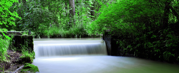 panoramic view of a waterfall in the English garden in Munich