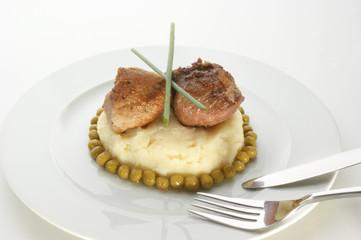 medallion of pork fillet mashed potato and pea