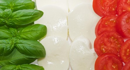 Italian flag made of basil mozzarella and tomato