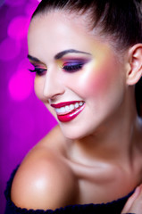 Portrait of beautiful young sexy woman on crimson background