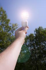 Energy saving light bulb lit outside
