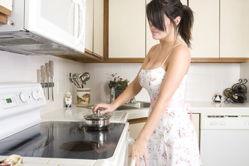 beautiful brunette housewife working in her kitchen