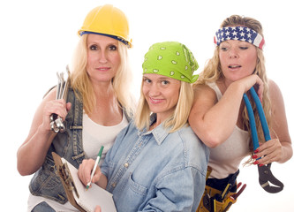 team of three sexy women workers contractors with tools