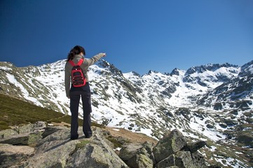pointing a big snow mountain