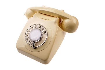Rotary dial telephone over white