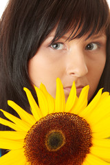 Young woman with a big sun flower