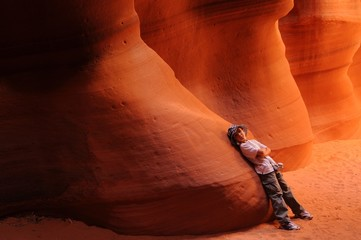 Boy resting in Antelope Canyon