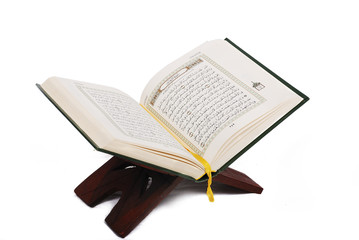 Holy islamic book Koran opened and isolated Wall mural