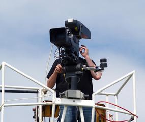 Cameraman working at bring you the news