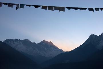 Prayer flags at sunrise, Himalaya mountains, Nepal