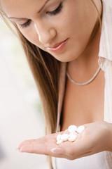 Girl holding pills