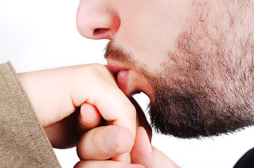 Young male model kissing female hand closeup