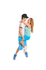 Young couple hugging on white