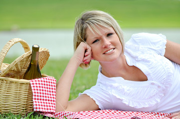 Young Blond Woman on Picnic with Wine