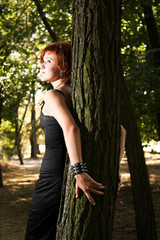 Young single woman in forest