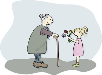 kleines Mädchen schenkt Omi Blumen