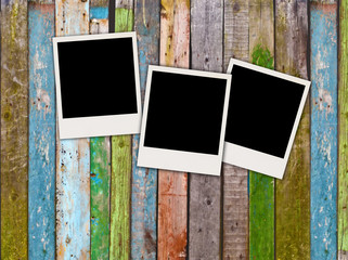 Three Blank Polaroids on Wooden Background
