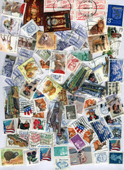heap of different vintage post stamps, paper texture, frame