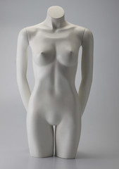female mannequin naked on the plain background