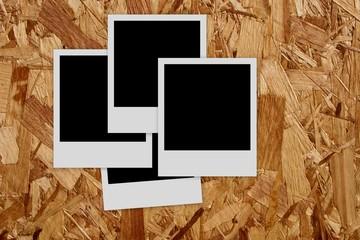 Pile of  empty photo frames  on wood background