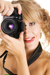 Cheerful young woman taking a picture