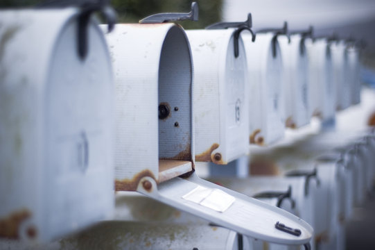 mailbox open in row of mailboxes
