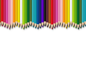 colored pencils aligned on white background