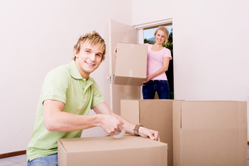 young couple moving into rented home