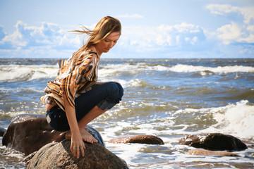 Women on the beach near stones in Latvia
