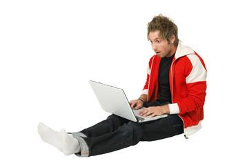 Surprised man using laptop